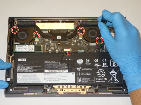 Remove the four 3 mm Phillips #0 screws from the fan assembly.