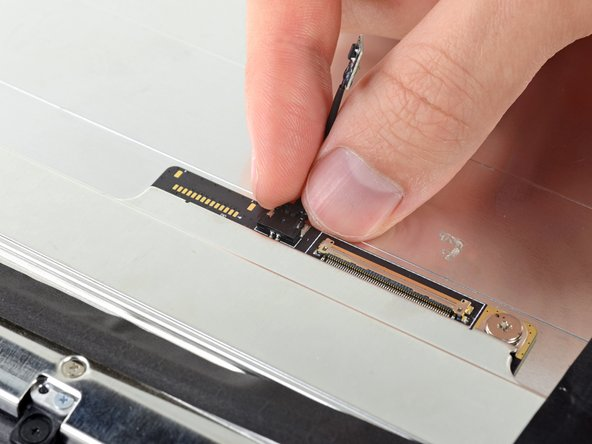 Disconnect the thermal sensor from its socket on the back of the display.