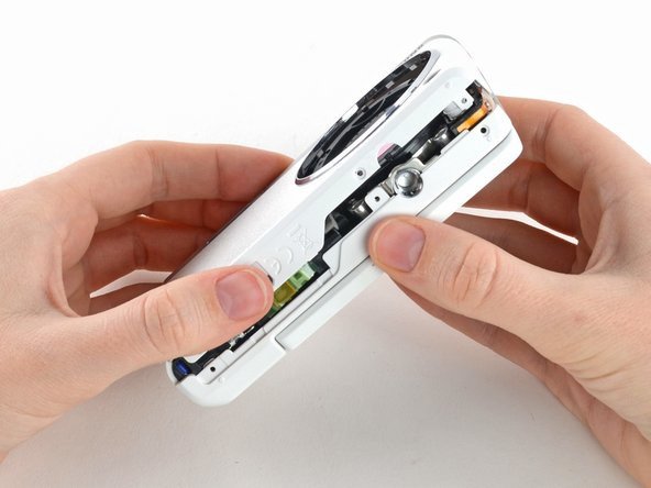 Use your hands to slowly pull the front casing away from the camera.