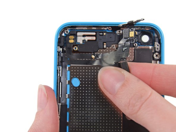 Peel the upper assembly cable up from right to left to separate the adhesive holding it to the case.