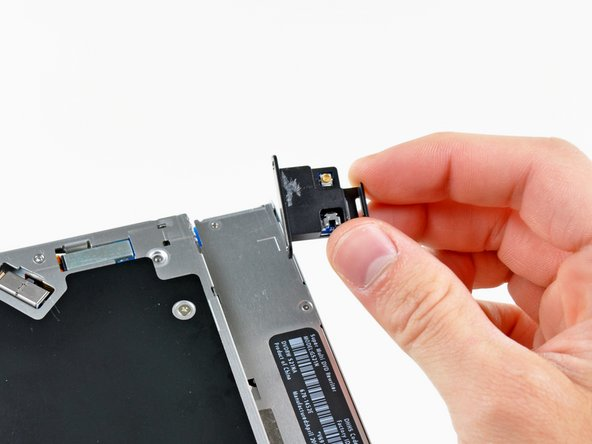 Remove the Bluetooth board from the optical drive.