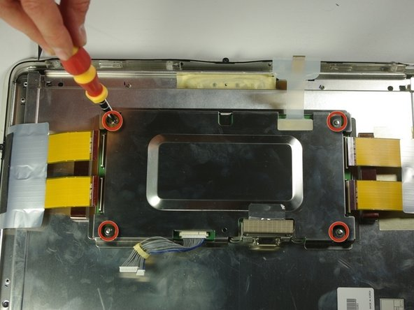 Unscrew the four screws (4.79x2.33mm) on the metal box using the PH 2 screwdriver.