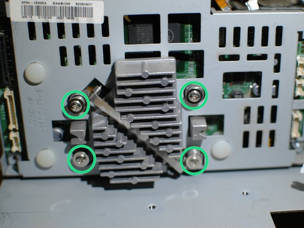 Remove the four spring-loaded screws that reside on each side of the heatsink. These screws apply pressure to the DMD board to hold it in position, under tension - once adjusted at the factory the the DMD board needs to be held in place over the long term or the picture quality will suffer.