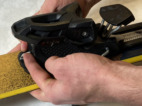 With the lever raised, slide the heel piece until the markers point to the correct range of the boot size.