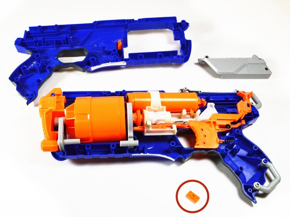 Once the screws have been removed, lift the top half of the gun off.