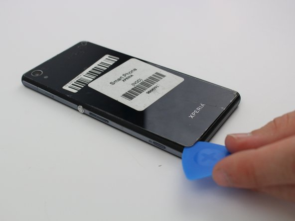 Apply a suction cup tool to the center of the back panel and gently pull the panel off the back of the phone.