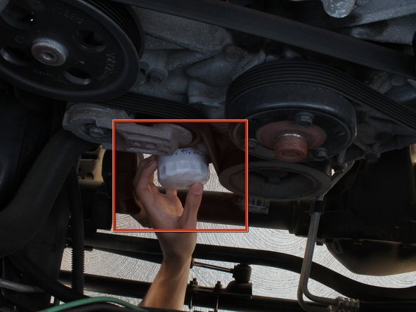 Use an oil filter wrench to loosen the oil filter. Twist it to the left to remove the filter.