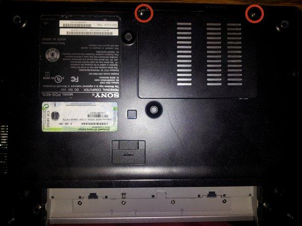 Remove memory/wireless compartment cover.