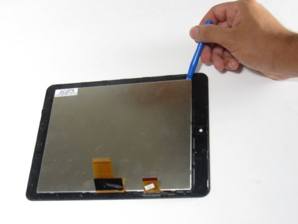 Use a plastic opening tool to pry the LCD display away from the screen.
