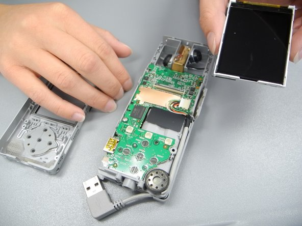 Gently slide the ribbon from the circuit board, removing the screen.