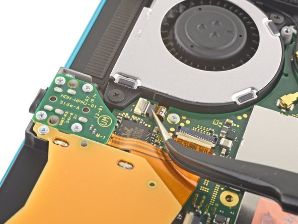Use a pair of tweezers to slide out the fan cable from its connector on the motherboard.