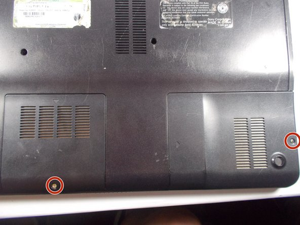 Remove the highlighted screws from the panels in the bottom right-hand corner of the laptop using the Phillips #0 Screwdriver.