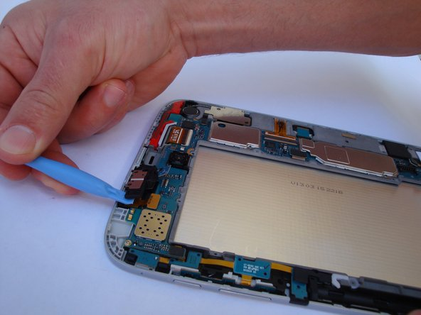 Remove the headphone jack from it's housing.