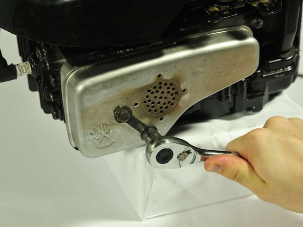 """Use a socket wrench with a 7/16"""" hex bit or 7/16"""" wrench to remove the two remaining 75mm screws."""