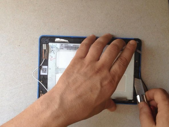 The LCD display is held by metal frame and some locking clips on it.