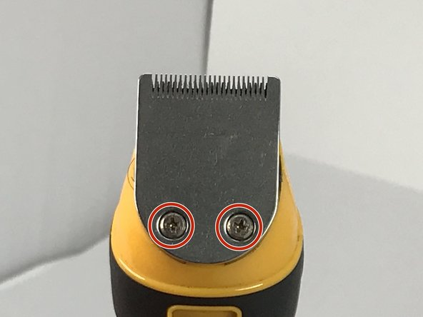 Using a Phillips #0 screwdriver, remove the two screws holding the trimmer blade in place.