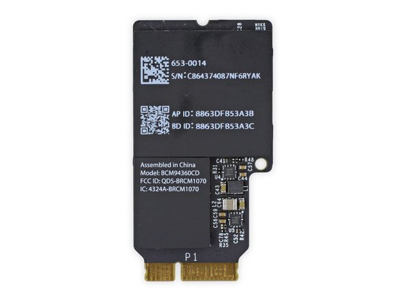 The AirPort/Bluetooth card, identified by its model number BCM94360CD, is exactly the same as the one we encountered in last year's iMac Intel 27 inch:
