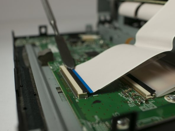 Gently separate the ribbon cable from from ZIF connector on the circuit board using a metal smudger.