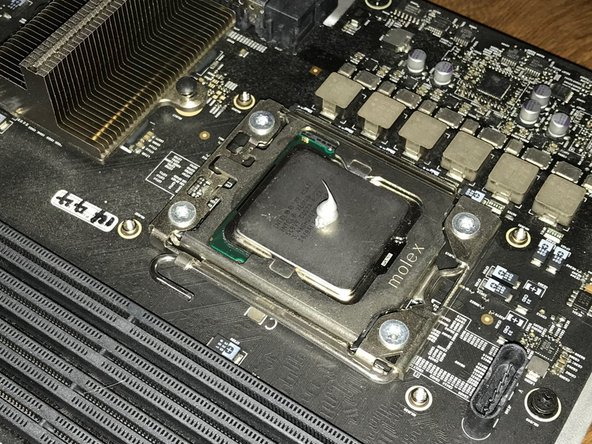You'll need to re-apply thermal paste to the new processor. There are many schools of thought on the best way to do this, but I prefer to place a pea-sized dot in the middle of the CPU and let the heatsink spread it out for me.