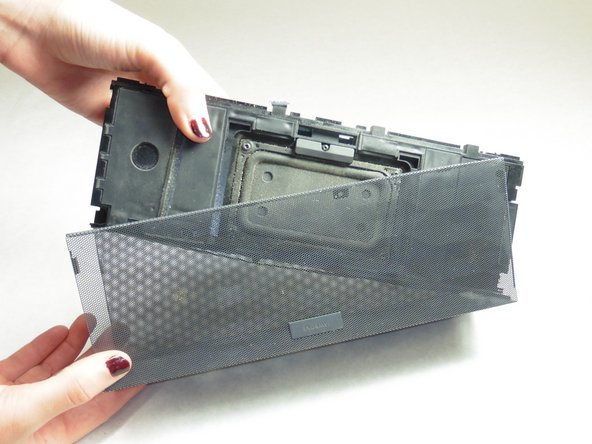 Once all eight screws are removed, pry the sides of the Jambox to lift the body from it's shell.