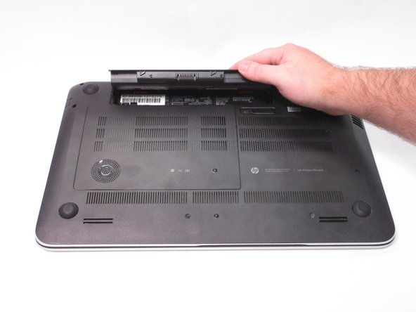 Remove the battery from the laptop, it will come out easily.