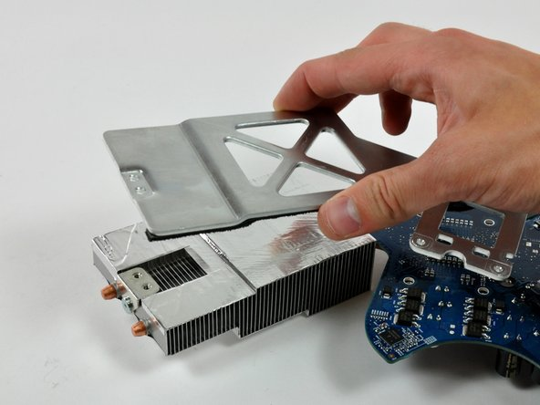 Lift the heat sink bracket up off the heat sink and the logic board.