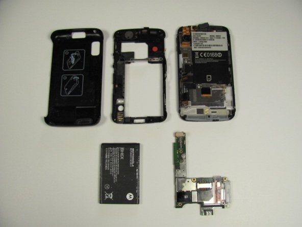 After disconnecting the motherboard, there should be five distinct and separate parts of the phone: back cover, back case, front case, battery, and motherboard.