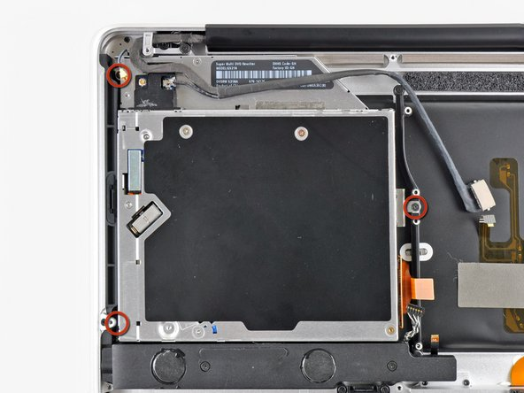 Remove the three 3.5 mm Phillips screws securing the optical drive to the upper case.