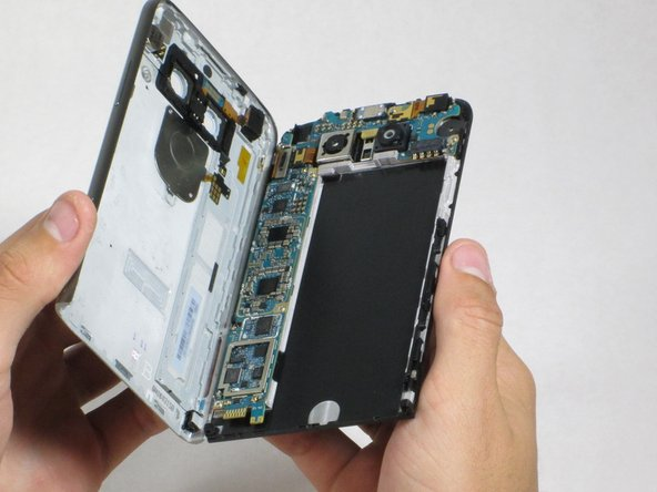 Peel the screen away from the body.  The two parts should be completely separated.