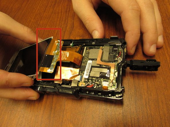 Carefully unclip the screen from its circuit ribbon.