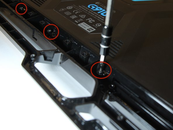 """Flip the keyboard and unscrew the """"15"""" back screws."""