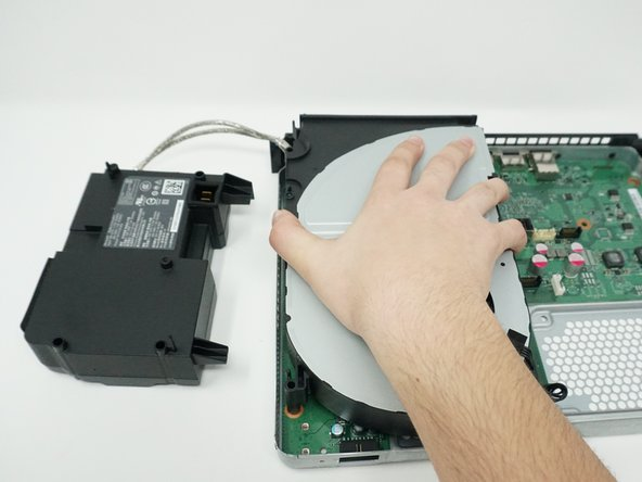 Remove the cooling system by lifting it vertically off of the motherboard.
