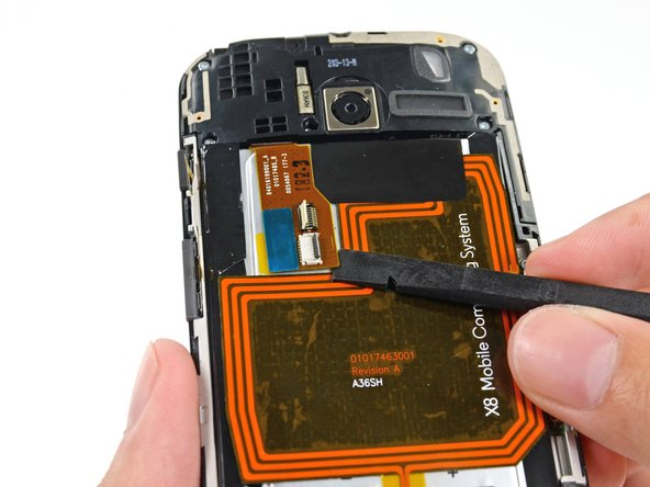 Insert the flat end of a spudger under the interconnect cable to free it from the adhesive holding it to the battery.