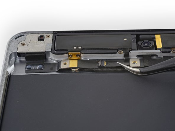 Use tweezers to pull the antenna ribbon cable from its ZIF socket on the headphone jack ribbon cable.