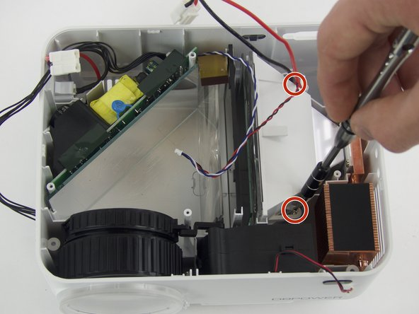 Remove the two (3 mm) screws connecting the bracket down and pull out the reflector, using a  J0 Philips Head Screwdriver.