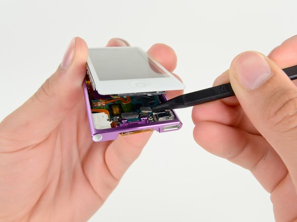 Use a spudger to release the digitizer cable and display data cable connectors.