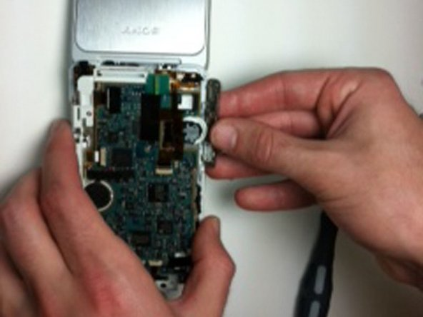 Remove the volume rocker from the side panel of the device.