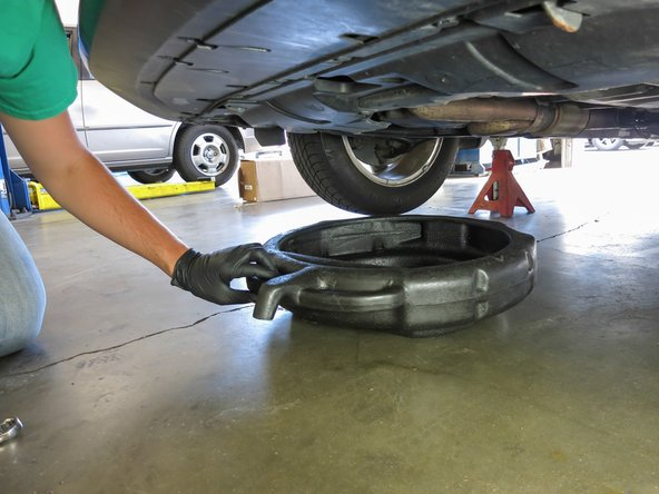 Place oil pan  between the front tires