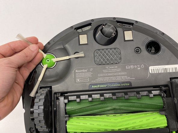 After unscrewing the side brush screw, gently pull the brush up, as shown in the picture.