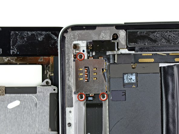 Remove the three 2 mm Phillips screws securing the SIM slot to the rear panel.