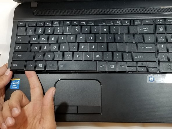 Using hands, gently pull keyboard  out of device.