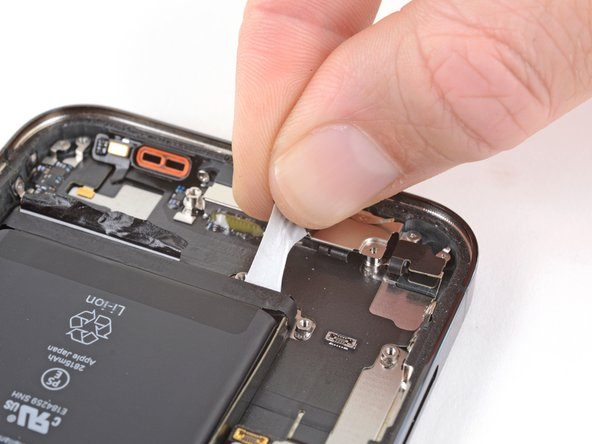 Grab the first pull-tab with your fingers and slowly pull it away from the battery, toward the bottom of the iPhone.