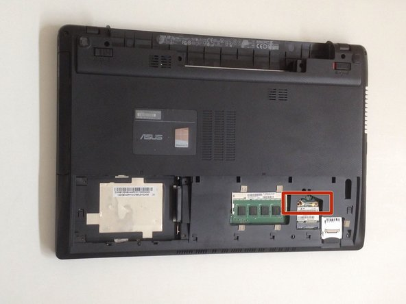 Disconnect the two coaxial antenna cables from the Wi-Fi card.