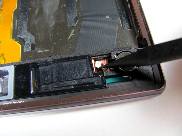 Disconnect the vibrate motor flux cable by using the spudger to gently pop it up.