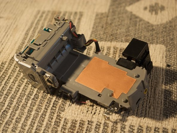 Under the logic board there is this piece of plastic, separating the lens and sensor from the rest of the camera.