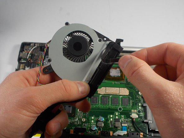Remove the tape holding the fan and heat sink together.