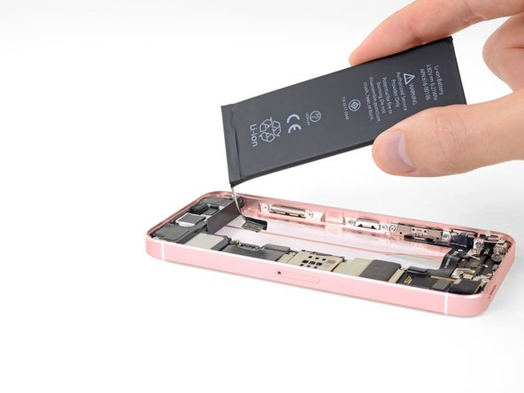 Without sticking the battery down, lower its connector into the iPhone and align it to its socket on the logic board.
