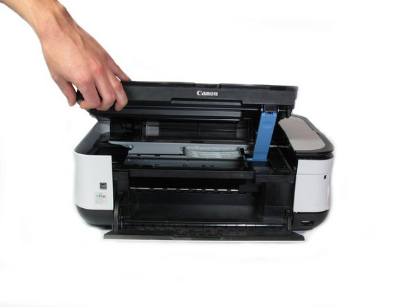Lift the scanner compartment.