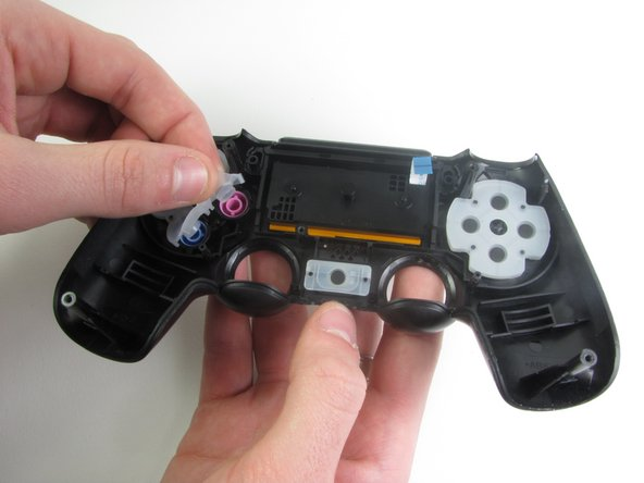 Remove the rubber covering concealing the buttons with your fingers.