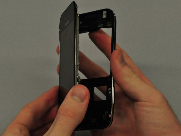 Once the clips are detached, separate the main case from the LCD touchscreen.
